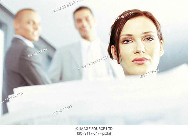 Businessmen teasing businesswoman