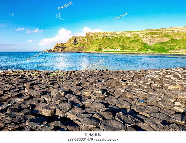 Giants Causeway, unique geological hexagonal formations of volcanic basalt rocks and cliffs on Atlantic coast in County Antrim, Northern Ireland