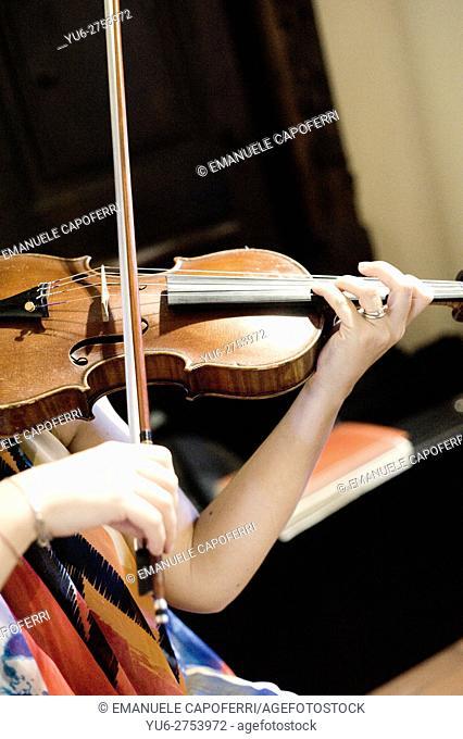 Woman plays violin