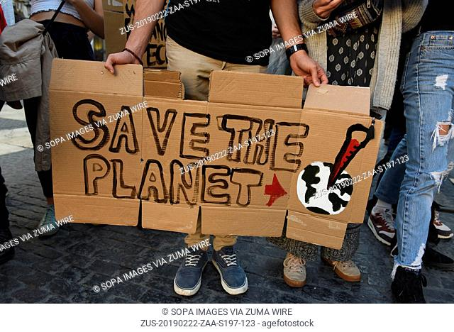 February 22, 2019 - Barcelona, Barcelona, Spain - A man is seen holding a placard reading 'Save the planet' during the protest