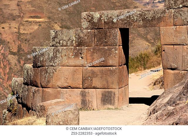 A stone door at the Inca terraces in Pisac Ruins of the Inca empire, Cusco Region, Peru, South America