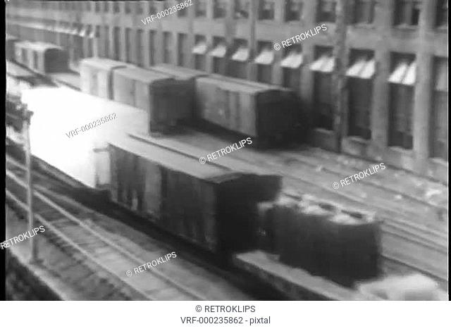 High angle view of freight train moving through freight yard