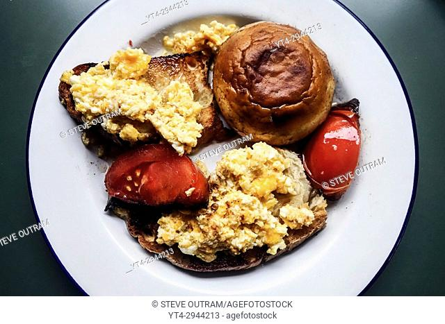 Healthy Breakfast of Scrambled Eggs, Toast, Mushroom and Tomatoes