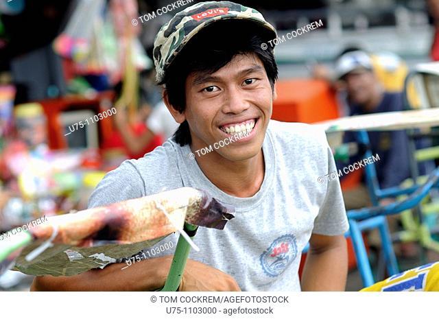 pedicab driver carbon market downtown cebu city philippines