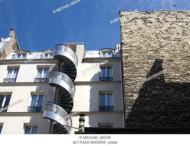 Apartment buildings with spiral staircase on outside
