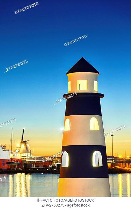 Lighthouse monument at the harbor. Denia. Alicante. Valencia Community. Spain