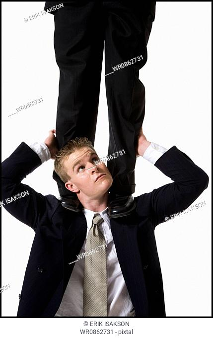 Businessman supporting colleague on shoulders