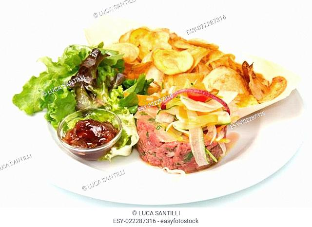 raw ground beef with chips and salad