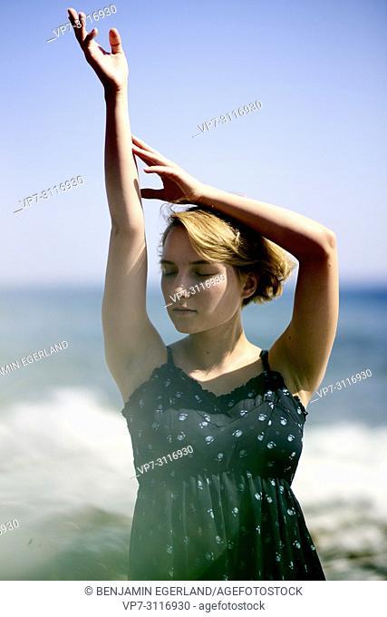 woman at beach in holiday destination Chersonissos, Crete, Greece, sensual, breeze, holiday