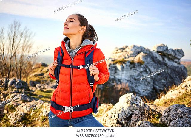 Woman on a hiking trip in the mountains having a break