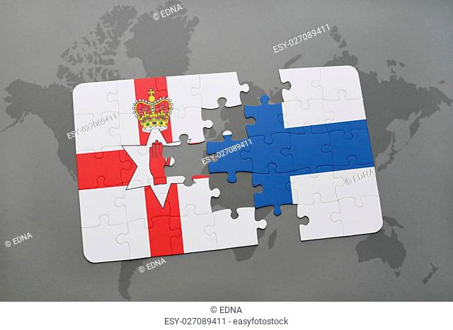 puzzle with the national flag of northern ireland and finland on a world map background. 3D illustration