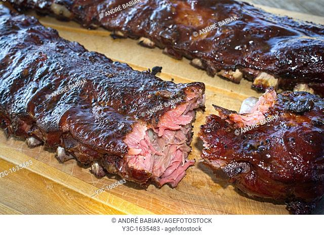 Juicy and tender barbecue spareribs torn apart