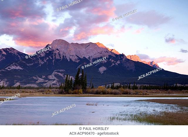 Rocky Mountains at sunset with Athabasca River in the foreground, Jasper National Park, Alberta, Canada