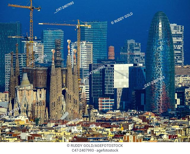 Sagrada Familia and Agbar Tower in foreground. Diagonal Mar buildings in background, Barcelona, Catalonia, Spain