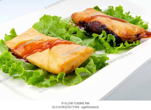 Close-up of fried dough pockets on lettuce