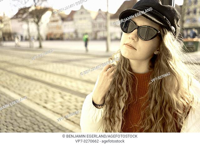 young woman wearing sunglasses, in city Cottbus, Brandenburg, Germany