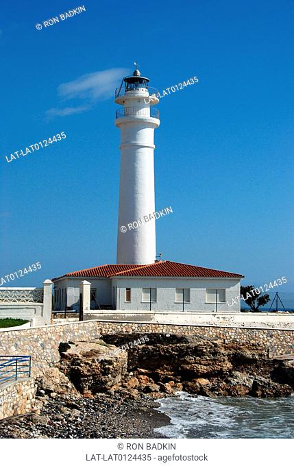There are many lighthouses along the Costa del Sol. This lighthouse is on the coastline at Torrox Costa,an especially rocky part of the coastline presenting a...