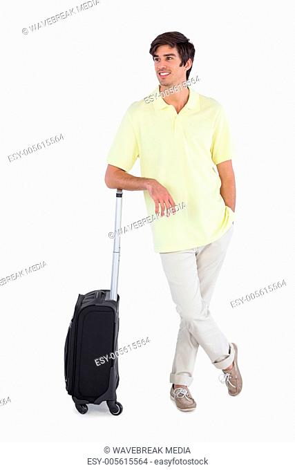 Happy man standing with his suitcase