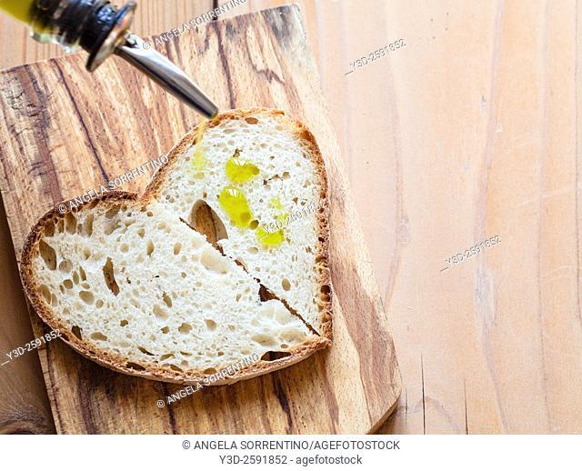 Olive Oil on Bread, on woodden cutter board