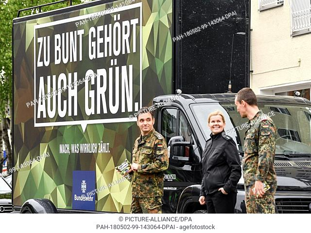 02 May 2018, Germany, Berlin: Soldiers from the German armed forces standing with an advertising board in front of the internet conference re:publica