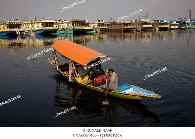 Shikara and the floating market of Srinagar, capital of Kashmir, India. This is a 'village' of so-called house boats for foreigners and tourists where sales men...