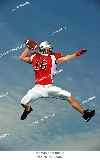 Quarterback making pass