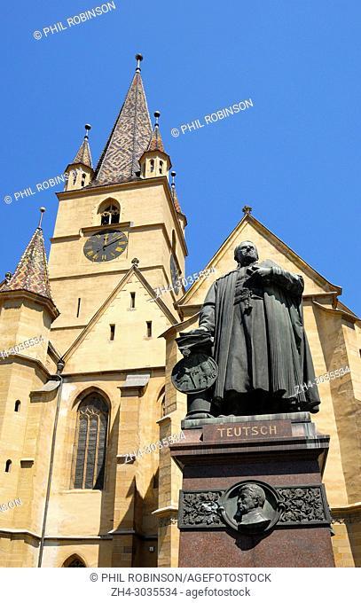 Sibiu, Transylvania, Romania. Lutheran Cathedral of Saint Mary / Evangelical Church (1300-1520; Gothic) in Piata Huet (square) Monument to Georg Daniel Teutsch...
