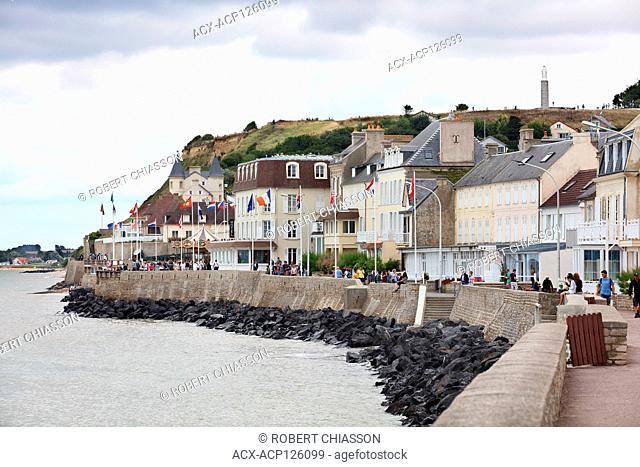 Walking path on the water's edge in the tourist town of Arromanches-les-Bains which played an important role during the D-Day landing in WWII, Normandy, France