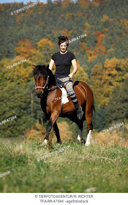 woman rides crossbreed