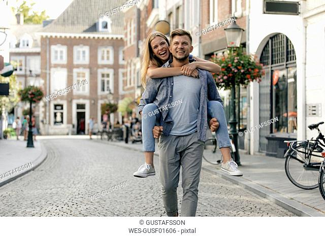 Netherlands, Maastricht, happy young couple in the city