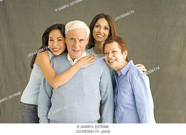 Mother, father and daughters smiling