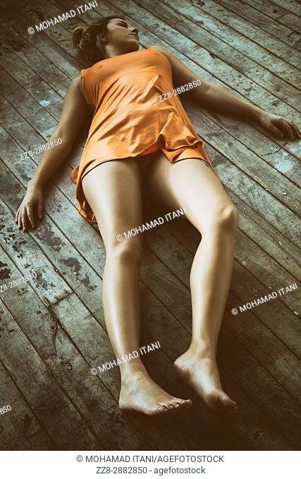 Dead woman's body laying down on the floor