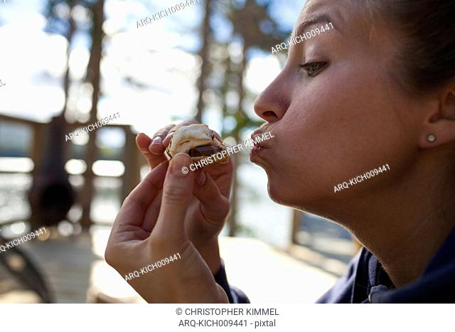 A Young Woman Enjoy Eating A Delicious S'more