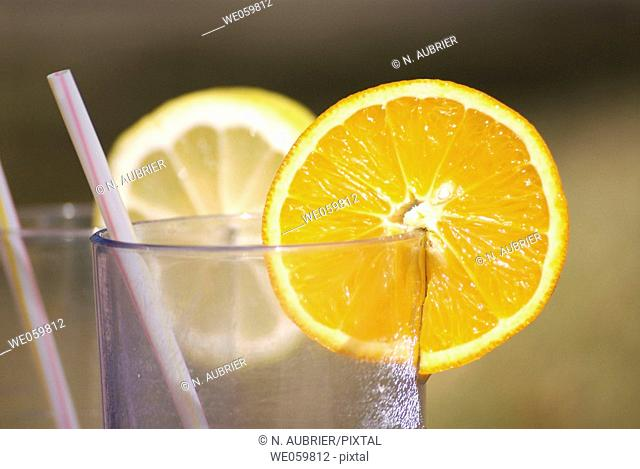 Lemon and orange slices on glasses