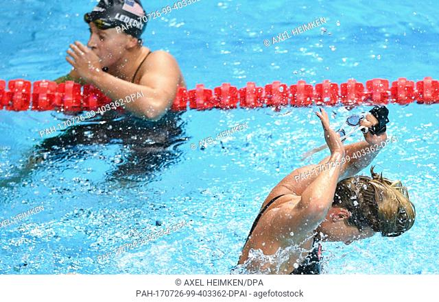 Italy's Federica Pellegrini (R) celebrates her victory in front of USA's Katie Ledecky in the women's 200m freestyle final at the FINA World Championships 2017...