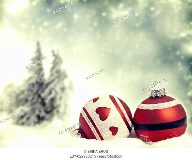 Red Christmas decorations in the snow