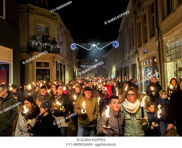 Tilburg, Netherlands. Annual, 2018 Christmas Eve torch procession for Peace roaming down town with light. The procession is a new alternative for going to...