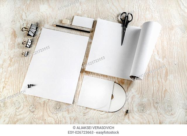 Photo of blank stationery. Corporate identity template on light wooden background. For design presentations and portfolios