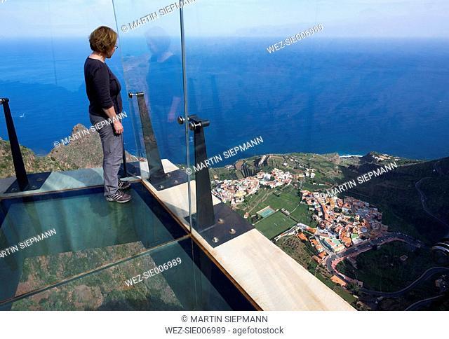 Spain, Canary Islands, La Gomera, Agulo, Mirador de Abrante, woman standing on skywalk