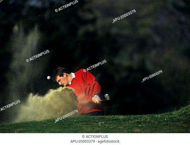 Golfer chips the ball out of the bunker