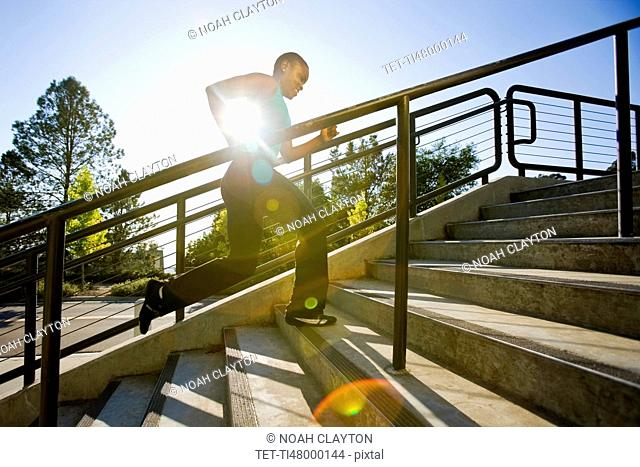 Woman running on steps