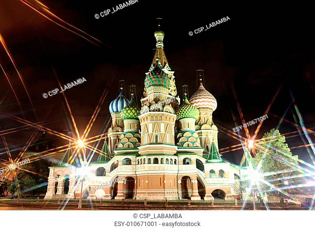Night view of Intercession Cathedral St. Basil's through rays of lamp on Red square, Moscow, Russia