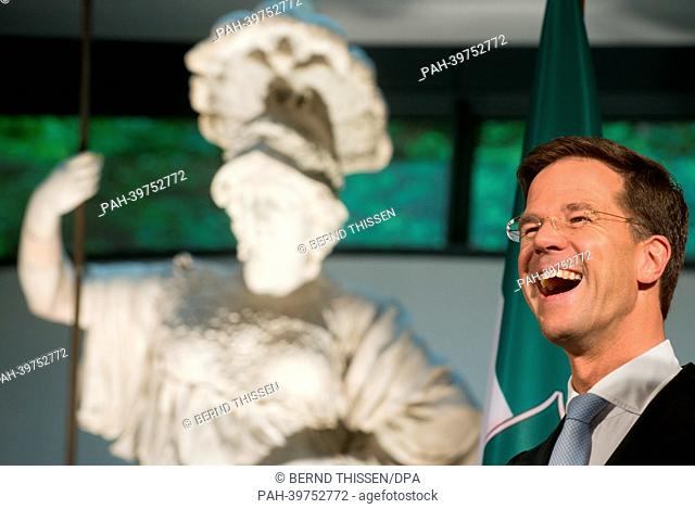 Dutch Prime Minister MarkRutte laughs a reception for first German-DutchCabinet Meetingat the Kurhaus Museum in Kleve, Germany, 23 May 2013
