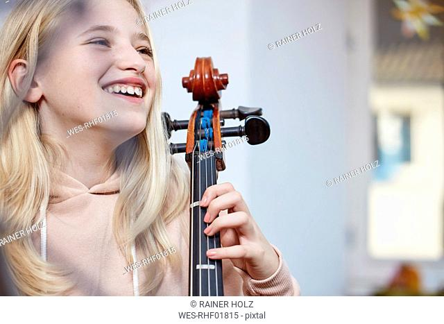 Portrait of happy girl with cello