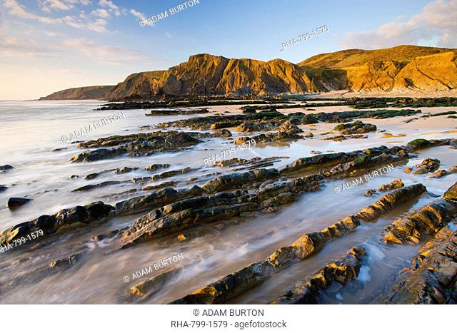 Eroded ledges exposed at low tide, Sandymouth, North Cornwall, England, United Kingdom, Europe