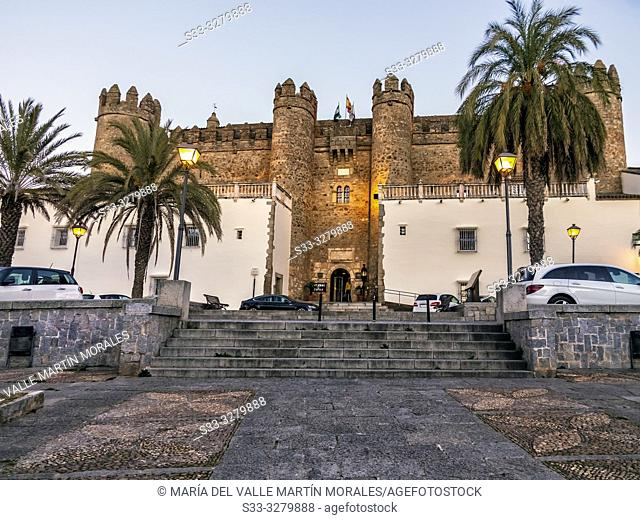Battlements and flags in the Parador of Zafra. Badajoz at sunset. Spain. Europe