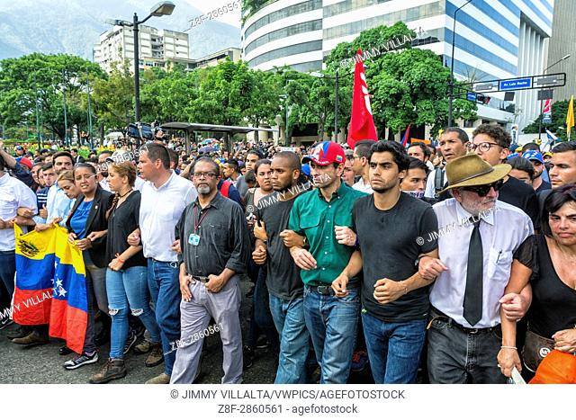 Students of the murdered youth and political leaders march in a homage through the streets of Caracas. People participate in a march paying homage to student...