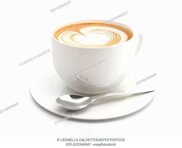 Cappuccino mug close up, with a heart decorated on top of foam. Some depth of field effect. On white background with clipping path