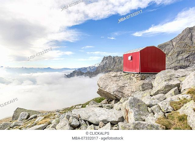 Lombardy, Italy, the Molteni biwak in Ferro valley clouds above. Masino valley