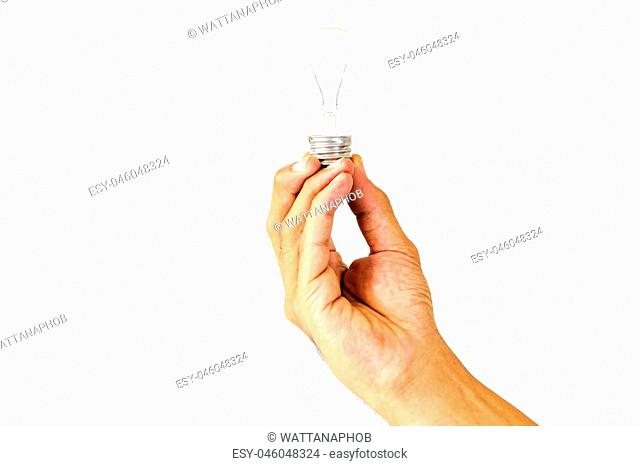 Man's hand holding an incandescent bulb isolated on white background with clipping path concept for energy savings